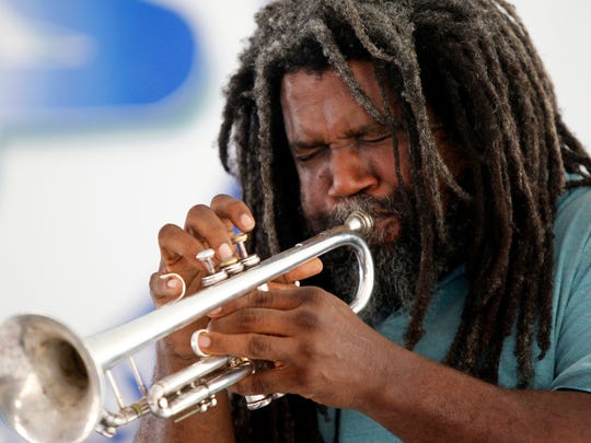 Jeff Lofton of Austin solos on the trumpet Saturday, Oct. 20, 2012 as he performs with members of the James Polk band during the 52nd annual Texas Jazz Festival at Heritage Park in Corpus Christi.
