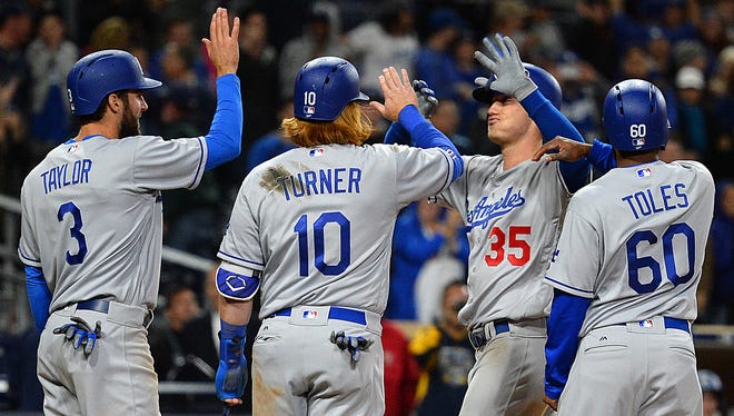 Rookie Cody Bellinger, center, has emerged as a critical member of the Los Angeles Dodgers, filling in at both first base and the outfield, and posting an OPS over 1.000 in his first month in the majors.