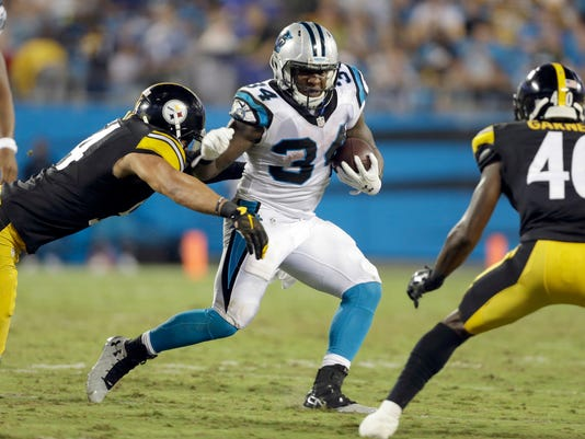 Carolina Panthers' Cameron Artis-Payne (34) runs against Pittsburgh Steelers' L.J. Fort (54) and Montell Garner (40) in the first half of a preseason NFL football game in Charlotte, N.C., Thursday, Sept. 1, 2016. (AP Photo/Bob Leverone)