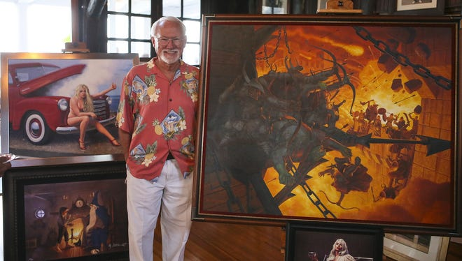 Artist Greg Hildebrandt of Lake Hopatcong.  Greg Hildebrandt, of Lake Hopatcong, smiles next to some of his paintings during the Lake Hopatcong Foundation's annual Gala Art Auction and Wine Tasting at the Lake Hopatcong Yacht Club.
