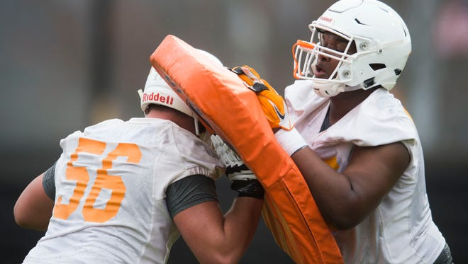 From left Tennessee's Riley Locklear (56) and Jerome Carvin practice during the first Vol football practice of the spring season at University of Tennessee in Knoxville, Tuesday, March 20, 2018.