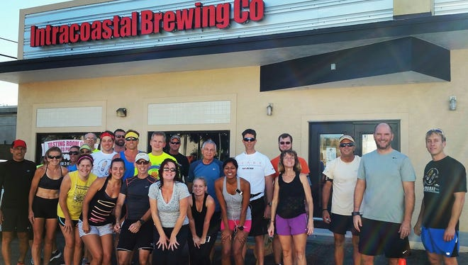 Runners in front of Intracoastal Brewing Co. in Melbourne.