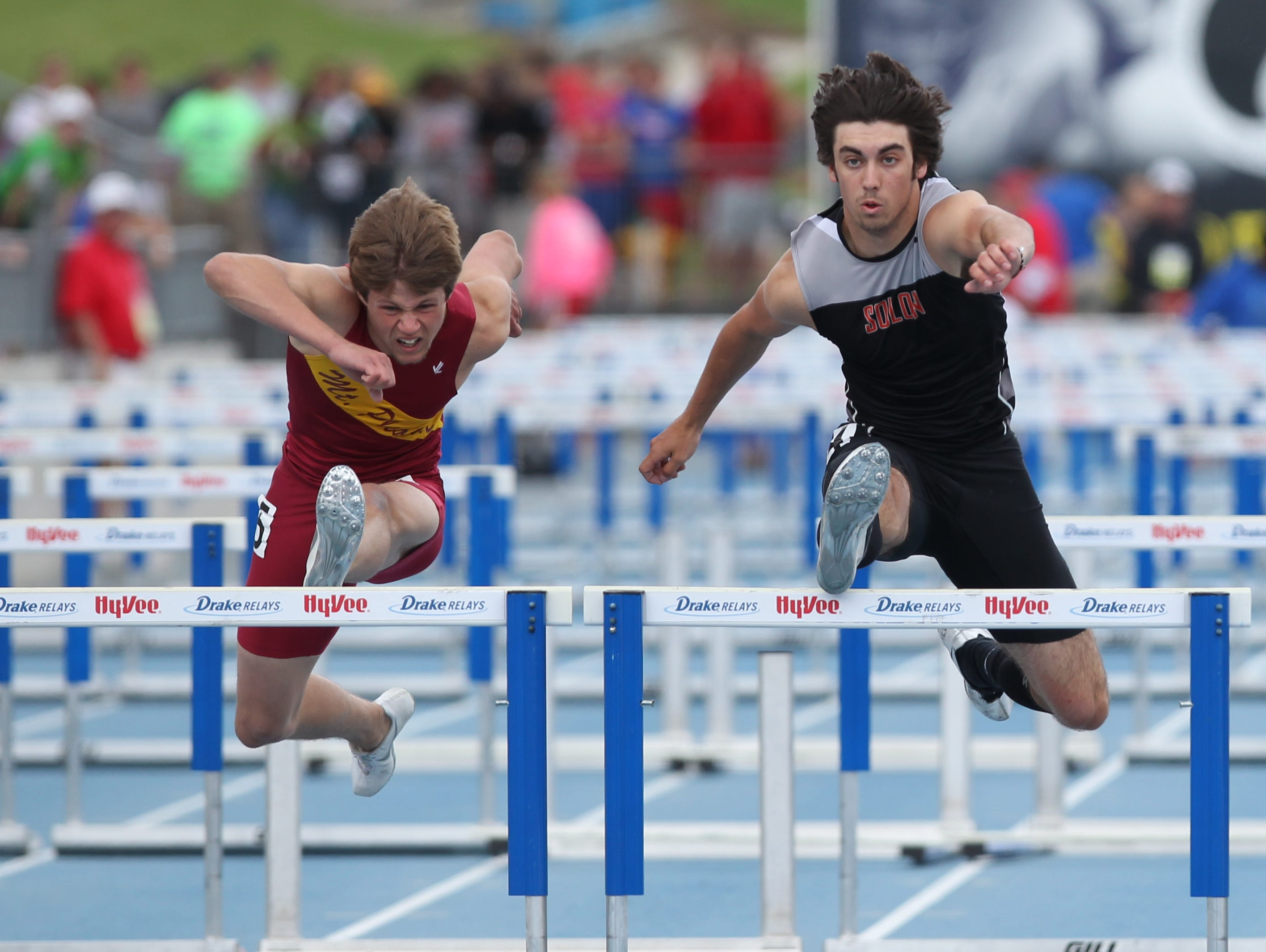 Connor Ham of Solon edges out Cole Phillips of Mt. Pleasant to win the 3A Boys 110 Meter Hurdles at the Iowa High School State Track Championships at Drake Stadium.