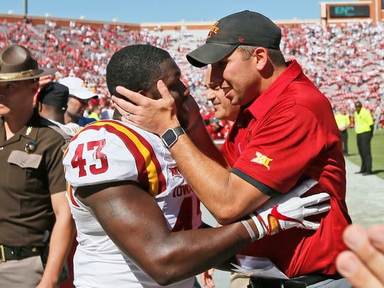 Iowa State head coach Iowa State head coach Matt Campbell, right, celebrates with linebacker Tymar Sutton (43) following an NCAA college football game against Oklahoma in Norman, Okla., Saturday, Oct. 7, 2017. Iowa State won 38-31. (AP Photo/Sue Ogrocki)
