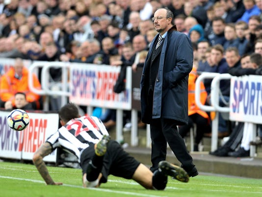Newcastle United manager Rafael Benitez looks out from the touchline during the game against Stoke City during their English Premier League soccer match at St James' Park in Newcastle, England, Saturday Sept. 16, 2017. (Owen Humphreys/PA via AP)