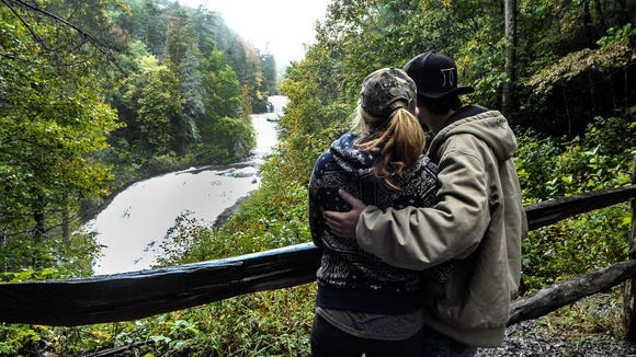 A young couple enjoying the view of Triple Falls in DuPont State Forest during the Tour de Falls event on Sat.
