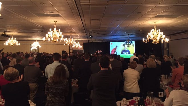 David Dranbauer, the Hanover man responsible for catching an alleged arsonist, gets standing a standing ovation at the Red Cross heroes breakfast Thursday.