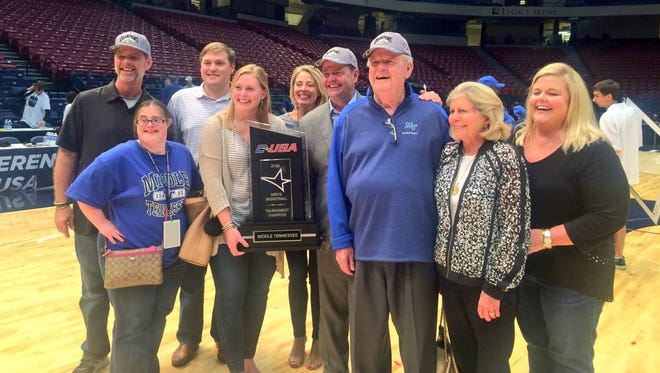 MTSU head coach Kermit Davis Jr. (center) with his parents and family after winning the 2015 Conference USA Tournament.