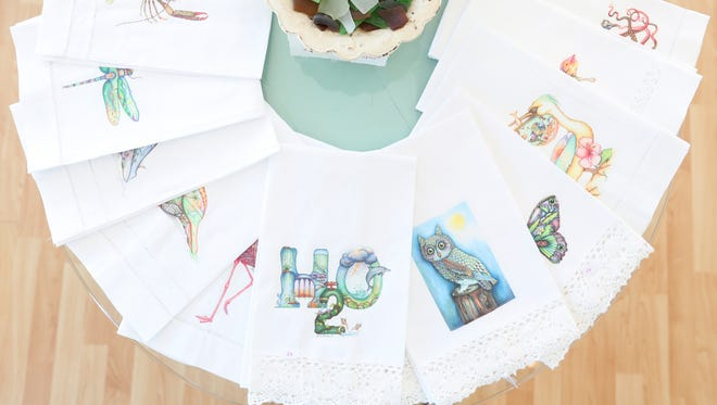 Hand towles with Butler's prints on them. Nora Butler designs and creates very unusual Florida themed items such as bags, wall art, and clothing. She has a small corner shop in south Naples.