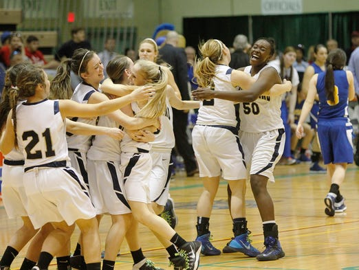 Pittsford Sutherland celebrates after defeating Maine-Endwell 43-39 in the semifinals of the Class A tournament on March 14 in Troy.
