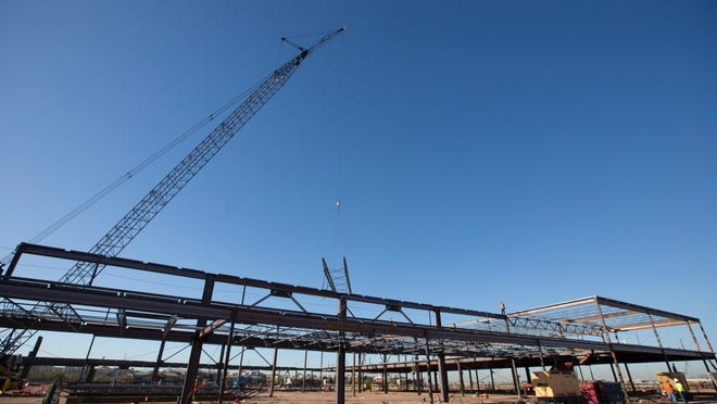 Construction workers erect steel framework for the Tohono O'odham Nation's West Valley casino southeast of Loop 101 and Northern Avenue.