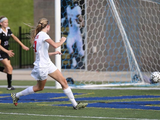 Watching her shot nestle into the back of the Woodhaven goal Friday is Canton's Raquel Church.