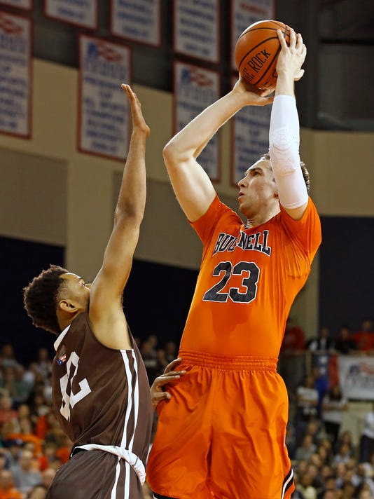 Bucknell's Zach Thomas (23) shoots over Lehigh's Brandon Alston (42) during the second half of an NCAA college basketball for the Patriot League tournament championship in Lewisburg, Pa., Wednesday, March 8, 2017. Bucknell won 81-65. (AP Photo/Chris Knight)