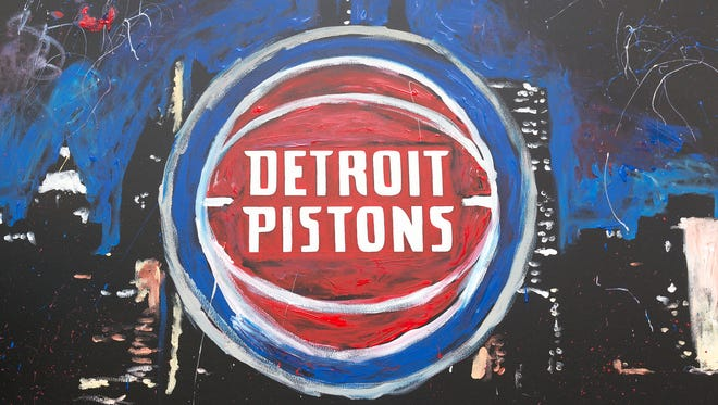 Speed finger painter, Jarred Emerson, unveils the new Pistons logo on May 16, 2017 at Campus Martius Park in Detroit.