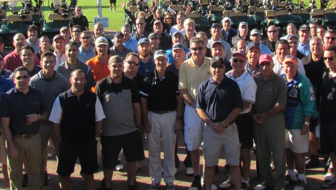 Golfers gather before a recent Duke Classic Golf Outing at Hendricks Field.