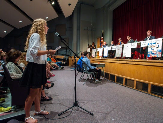 Student Cora Toland asks a question during a candidate's