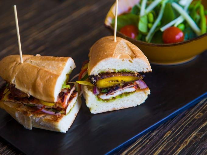 Chicken a la brasa sandwich with a side salad from