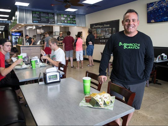Co-founder Paul Altero stands in the dining area of Bubbakoo's Burritos in Howell.