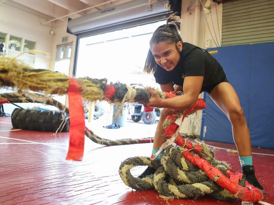 Palm Springs high school wrestler Cindy Zepeda works out during wrestling practice, February 21, 2018.