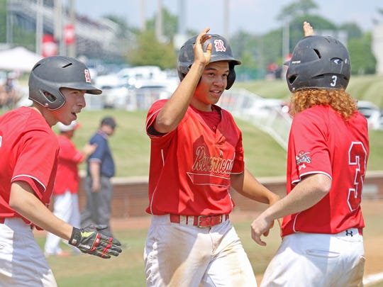 Cameron Sellers, Michael Robertson and Zachary Gray score runs for Riverheads at the Virginia High School League Class 1 state baseball championship at Radford University in Radford on Saturday, June 9, 2018.