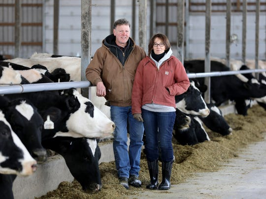 Dan and Linda Kundert on their dairy farm where they milk 90 cows near Monroe: They fear that four large wind turbines proposed for near their property will ruin their landscape, disturb their cows and possibly cause a variety of health effects.