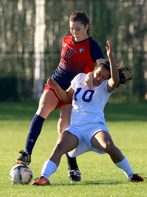 Veterans Memorial's Logan Shaw fights for the ball against Gregory.-Portland's Eliana Flores during the District 30-5A Championship game on Tuesday, March 14, 2017, at Cabaniss Soccer Field in Corpus Christi.
