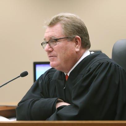 Supreme Court Justice Thomas Moran  addresses the jury.