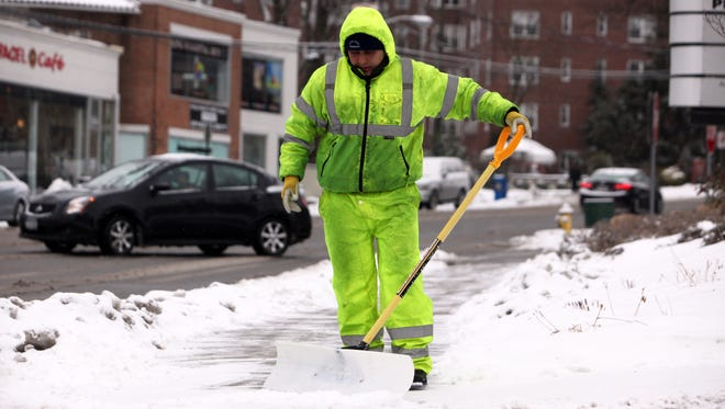 It'll be well above average temperatures for the next couple of days. Salvador Godoy, who works for Rose Hill Nurseries, clears the snow at Wykagyl Shopping Center on North Avenue, Dec. 17, 2013 in New Rochelle.