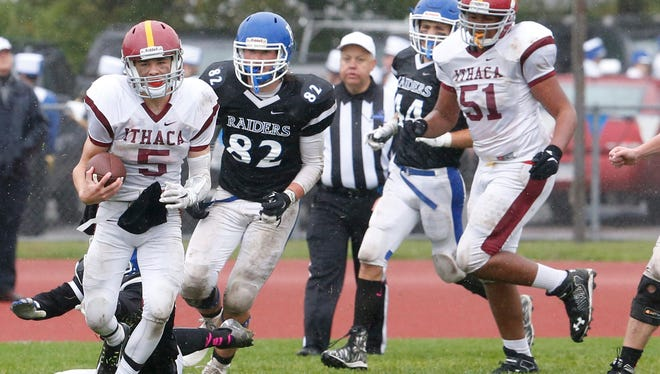 Ithaca quarterback Turner DePalma, 5, breaks away from a pair of Horseheads defenders during the Little Red's 37-6 loss to the host Blue Raiders on Saturday. DePalma finished the game with 132 yards on nine carries, including a 38-yard touchdown run in the third quarter.