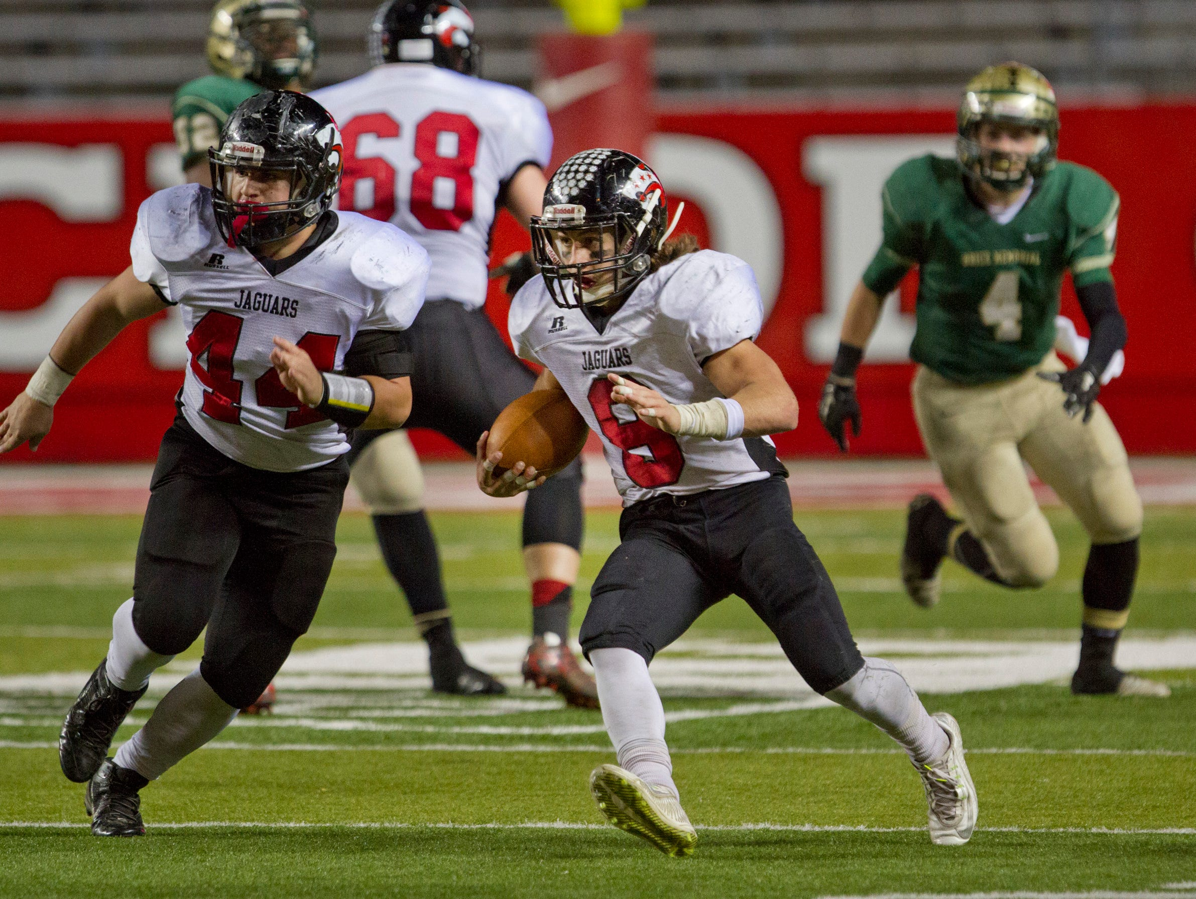 Jackson Memorial's Mike Gawlik looks for running room in Jackson Memorial vs Brick Memorial in 2015 NJSIAA Central Jersey Group Four Championship Final.