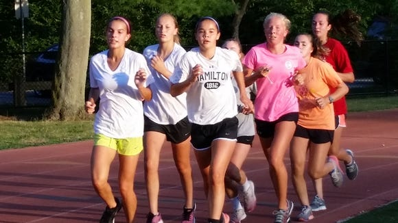 Members of Bronxville's girls soccer team jog around the track at Bronxville High School during a pre-season practice on August 24th, 2015.