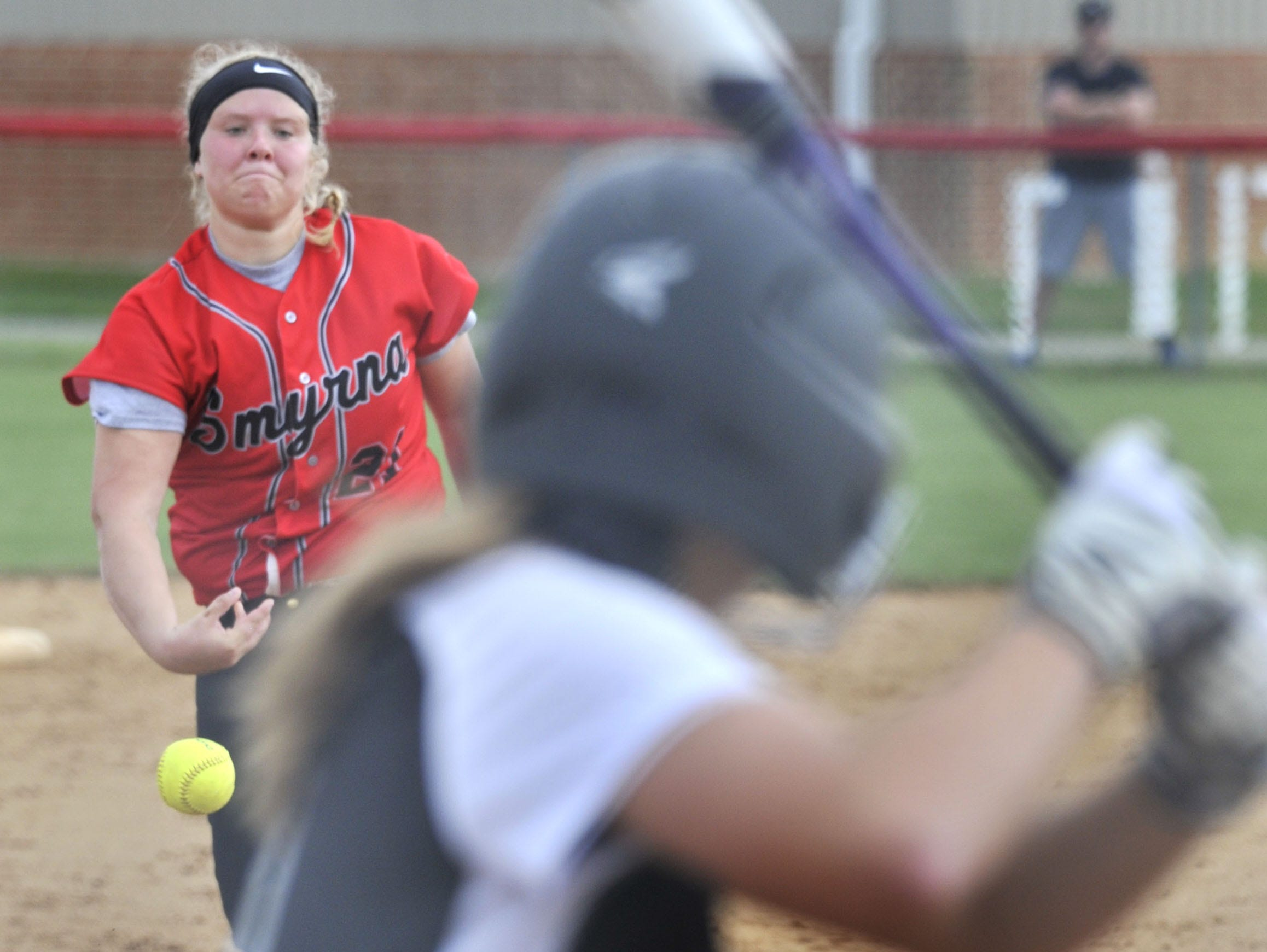 Smyrna pitcher Jessica Anderson sends a fast ball to the plate in game with Sussex Tech Thursday. The hit put the Ravens up 5-0.