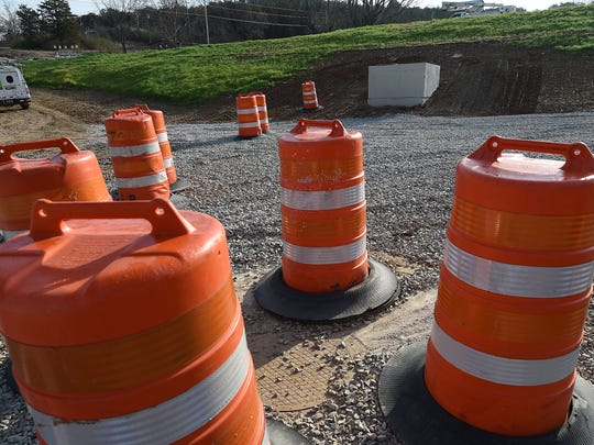 Safety cones mark an area where Arkansas State Highway and Transportation Department personnel plan on creating a no parking zone near two businesses on Fisherman Street in Norfork.