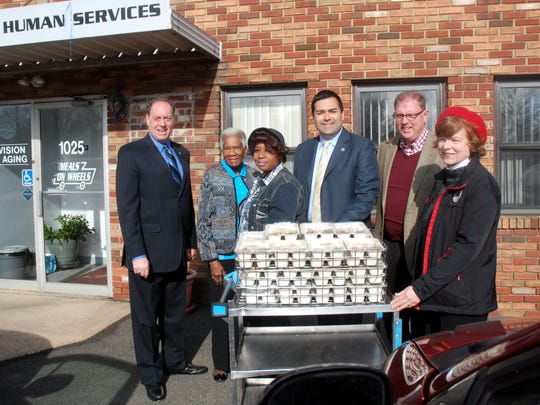 Union County officials visited with workers at the Union County Department of Human Services Meals on Wheels distribution center in Linden in mid March in honor of the 14th Annual March for Meals, a month-long celebration of Meals on Wheels designed to rally communities around the seniors who rely on its vital service to remain healthier and independent in their own homes. From left to right:  Union County Freeholder Chairman Bruce H. Bergen, Freeholder Vernell Wright, Meals on Wheels employee Tracey Hubbard, Freeholder Vice Chairman Sergio Granados, Sheriff Joseph Cryan and Freeholder Bette Jane Kowalski.
