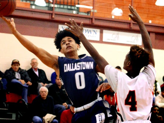 Dallastown's Braden Caldwell takes a shot with Central York's Saa'hir Cornelius defending during basketball action at Central Tuesday, Dec. 12, 2017. Bill Kalina photo