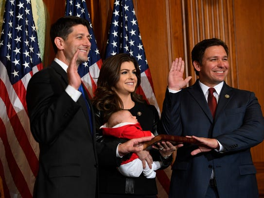 Washington, DC -- Rep. Ron DeSantis, R-Florida, with his wife Casey Black Desantis and their daughter Madison with House Speaker Paul Ryan, R-Wisconsin, for a ceremonial swearing-in and photo-op during the opening session of the 115th Congress.