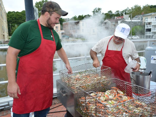 Gable Smith and Snookie Marino of Bridgeton check a batch of crabs at CrabFest