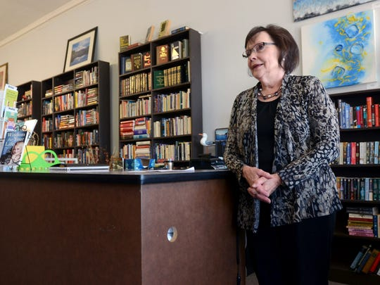 Waterway Books owner Pat Hoag, of Clay Township, talks about reopening her bookstore at its new location Sunday, Nov. 1, in Marine City.