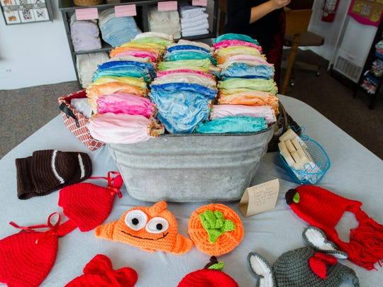 Handmade items are displayed Sunday, Oct. 2, 2016, at Mother Moon & Me in Sandusky.