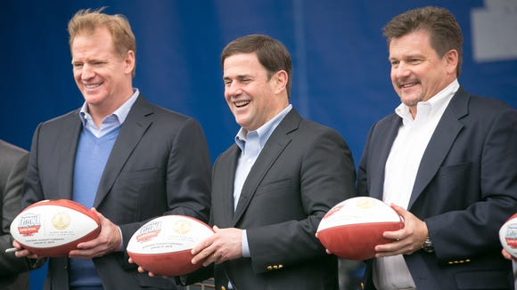 NFL Commissioner Roger Goodell, left, Gov. Doug Ducey