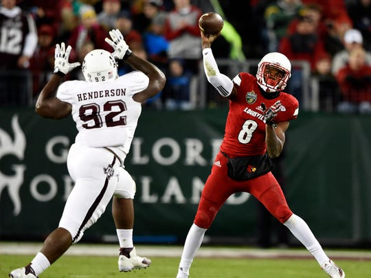 Louisville quarterback Lamar Jackson (8) passes against