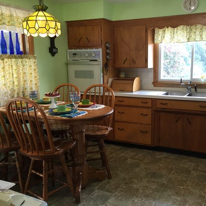 The kitchen's hardwoord cabinets are an original feature of the 1950s ranch home in Jeromesville.