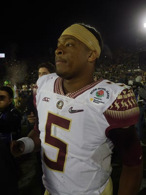 Florida State Seminoles quarterback Jameis Winston (5) walks off the field after losing to the Oregon Ducks in the 2015 Rose Bowl college football game at Rose Bowl.