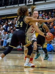 Freshman guard Avery Brunk dribbles through traffic during the Ventura College women's basketball team's 65-50 win over Los Angeles Valley on Saturday night in the CCCAA Southern California regional final at VC.