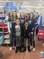 The Silver High cheer and dance teams helped out with