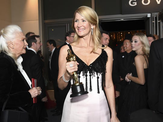"""Laura Dern, winner of the award for best actress in a supporting role for """"Marriage Story"""" attends the Governors Ball after the Oscars on Sunday, Feb. 9, 2020, at the Dolby Theatre in Los Angeles. Looking on at left is Diane Ladd. (Photo by Richard Shotwell/Invision/AP)"""