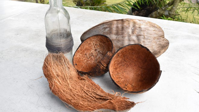 A coconut's shell and husk, along with fishing gear made from a glass bottle, fishing line and a hook, are shown. These are a few innovations described by Chamorro manamko'.