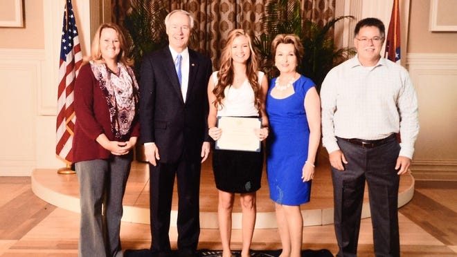 Summer Webers, third from left, of Mountain Home recently was honored at Scholastic Honors Day at the Governor's Mansion in Little Rock. Also shown are from left, her mother, Tracy Webers, Gov. Asa Hutchinson; first lady Susan Hutchinson and her father, Stuart Webers.