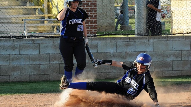 Evangel's Liz Adams slides into home fora run against Parkway on Tuesday while Leanna Cooper looks on.