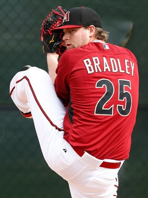 Arizona Diamondbacks pitcher (25) Archie Bradley delivers during spring training camp on Feb. 20, 2015, at Salt River Fields at Talking Stick.